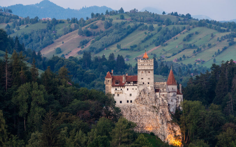 Bran Castle illuminated in rural landscape, Bran, Brasov, Romania